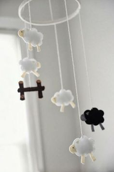 Nursery mobiles are usually ridiculously expensive, so I decided to make my own. I sketched out a few sheep until I had a shape and size tha. Sheep Mobile, Felt Mobile, Baby Mobile, Baby Kind, Baby Love, Counting Sheep, Baby Crafts, Diy For Kids, Decoration
