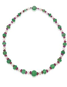 NATURAL PEARL, EMERALD, RUBY AND DIAMOND NECKLACE. Composed of 22 natural pearls measuring approximately 8.6 to 6.1 mm, spaced by 22 fluted emerald beads graduating from approximately 17.1 by 16.9 by 15.5 mm to 8.3 by 6.5 by 6.4 mm, further decorated with 44 ruby beads graduating from approximately 9.3 by 9.1 by 4.9 mm to 5.5 by 4.0 by 1.5 mm, completed by a clasp accented with small rose-cut diamonds, length 22 inches.