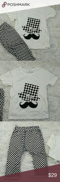 Black and white Mustache 2 pc set. Kids Adorable and comfortable 2 pc set of harem pants with a matching short sleeves tee.  Very cute item.  Crew neck. Short sleeves.  Have pockets. Pull up style.  This item is brand new and never used.?? with tags. Matching Sets