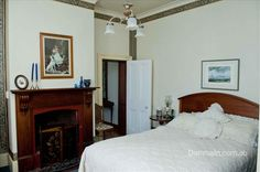 1860's Bedroom in Deloraine home, featuring high ceilings, coving, wood surround mantle, open fire & feature light. Oct'14