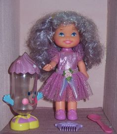 Cherry Merry Muffin Grape Ice Doll 1990.   She was the same size as my candy sprinkles doll and they both had baking accessories so naturally they were best friends.