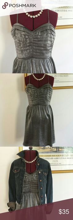 "Anthropologie silence & noise silver-grey mini How cute is this dress?  Rich pewter metallic mini features adjustable spaghetti straps and horizontal pleats along shaped bodice to waist.  Think that metallic colors are only for dressy occasions?  Bust 34"" Waist 28"" Sized 4 - runs small.  Rethink your style and throw on a jean jacket or blazer with sandals or boots.  You're going to exhaust your imagination as you try to create new looks!! Anthropologie Dresses Mini"
