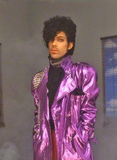 Prince with his purple jacket, 80s style. He rivaled Michael Jackson in popularity back then. Never thought Michael Jackson would surpass him in weirdness.