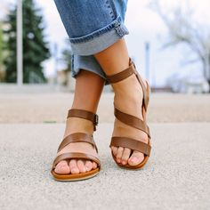 Flat sandal with ankle strap and buckles