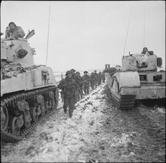 Men of Royal Scots Fusiliers pass between a Sherman and a Churchill tank during (Lowland) Division's attack towards Stein from Tuddern, 18 January 1945 Royal Canadian Navy, Canadian Army, British Army, British Tanks, Churchill, Ww2 History, Ww2 Photos, War Image, Ww2 Tanks
