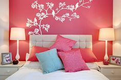 accent wall behind bed with white or black tree mural.  Butterfly mural in girls room.