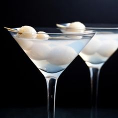 Lychee Martinis        * Ice cubes      * 6 ounces vodka      * 4 ounces lychee juice      * 1 ounce Sake      * 2 lychees, for garnish    Combine and shake in shaker.  Strain into Martini glasses and garnish with lychees.