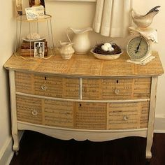 Dressing Up the Dresser: Decoupage is an time-honored way to add a personal touch to your furniture. Vintage maps, photographs, book pages, or even sheet music can transform a plain dresser into something truly individual.