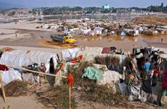 People living in tents made of polythene in Jaflong Stone Quarry, Bangladesh. One-third of the country's population lives below the poverty line