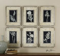 Uttermost Glowing Florals. These prints are accented by mats with a silver leaf look with aged, antique accents coming through the silver. Matching frames and fillets in silver leaf add the finishing touches to this artwork.