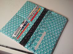 Tutorial on how to sew a clutch wallet with 12 card pockets, two cash pockets, and has a change zippered pocket.
