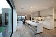 This premium Gaggenau kitchen is superbly appointed with marble benches, fabulous breakfast bench, integrated Liebherr fridge/freezer and butler's pantry