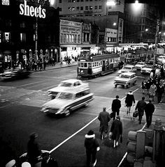 Crossing Swanston Street at Night Photo: Angus O'Callaghan Melbourne Australia.  Forty years ago Angus O'Callaghan chronicled the ordinary life of Melbourne, then his pictures were forgotten, consigned to a shoebox. Rediscovered they reveal a lost world, one that intrigues today's young collectors who are pushing prices for the prints higher and higher.