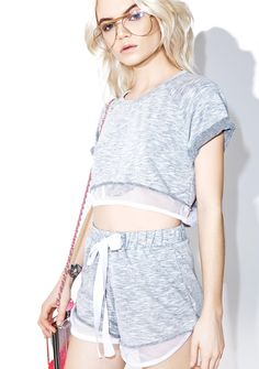 Studio Grind Sporty Set cuz yer gunna work 'til ya hit every move, bb! This dope crop top 'N shorts set features a comfy heather grey construction, boxy top fit with rolled sleeves, elasticized dolphin hem shorts, and curved white fishnet trim.