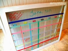 Artsy Vava - old window calendar with washi tape - via Remodelaholic