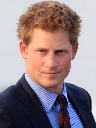 Prince Harry in blue and white check shirt, red tie and blue blazer. I like the combo.