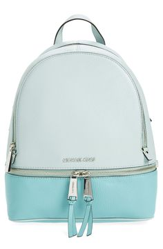 Adoring this leather backpack in shades of blue for a fun color-blocked look.