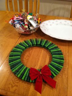 Card Holder Wreath- we made three this year, each wreath is made of 75 painted clothespins, hot glued to a wooden circular picture frame ( removed glass center) found at local shore craft store Homemade Christmas Gifts, Christmas Wreaths, Christmas Crafts, Christmas Decorations, Christmas Ornaments, Wreath Crafts, Diy Wreath, Clothespin Crafts, Clothes Pin Wreath