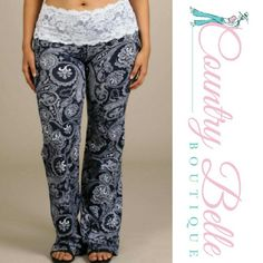 """Plus Size Dream Worthy lace Gaucho Pants These bottoms are a must have. It's so easy to look stylish and still be comfortable in these lace-waistband, slightly flared cotton knit pants. The elastic lace band makes them easy to slide on for a perfectly effortless """"get up and go"""" look.  Color: Navy Paisley Print  Fabric: Cotton/Spandex 95/5 Jersey  Made in USA 95% Cotton Jersey 5% Spandex Sizes: 10/12  XL = 14/16, 2XL = 18/20 , 3XL = 22 Inseam 35nches (tall) Pants Wide Leg"""