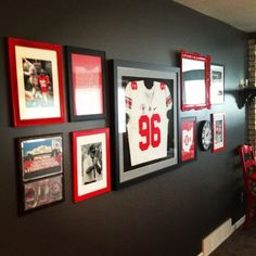 Exactly what I want to do. Black or dark grey walls. Bright accent photos and art Finally finished our Ohio State gallery wall!