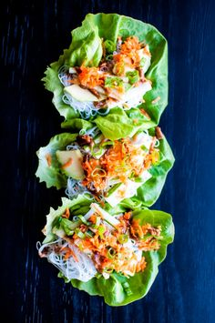 Fresh and easy vegetarian lettuce wraps that make a healthy, light lunch or crowd-pleasing appetizer. These lettuce wraps are filled with avocado, vermicelli, carrots, cucumber, and spring onions, then topped off with a sweet peanut sauce.