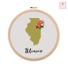 This item is a counted cross stitch pattern in PDF file format. The design is 64 stitches wide and 120 stitches tall. The embroidery hoop shown