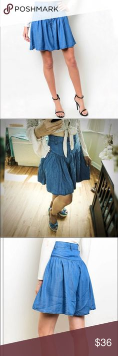 """High waist Tencel Skort New with tags Boutique Items  Very trendy but classic, dress up this denimlooking tencel skirt with your favorite body suit or top for a preppy look.  High Waist  100% Tencel Material  Width: 26"""", L: 38""""  Offers are welcome No trade  Thank you very much! Skirts"""