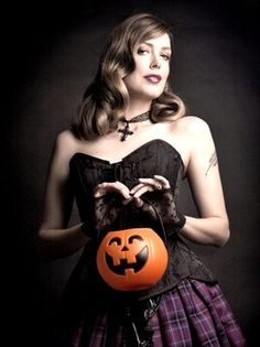 Author Tara Moss swathed in Gallery Serpentine Couture to celebrate Halloween, with the aid of her Jack O Lantern.    Image by Elizabeth Allnutt for Pan Macmillan publishers.