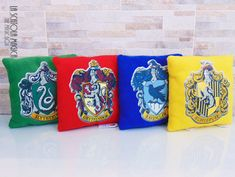 Harry Potter Hogwarts Houses - Ravenclaw, Gryffindor, Hufflepuff, Slytherin Plush Pillow - Handmade in Italy by LaScatolaMagica on Etsy https://www.etsy.com/no-en/listing/527391166/harry-potter-hogwarts-houses-ravenclaw
