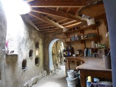 inside cob house | At one point, a formal, English style garden appears, surprisingly ...