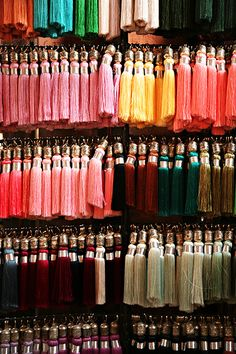 Tassels ~ Comical how Moroccan wearing a fez (Turkish: fes, plural fezzes or fezes), as well as its equivalent, the tarboosh ~ will twirl the tassel on top. Bracelets Fins, Passementerie, Tassel Jewelry, Moroccan Style, Textiles, Fringes, Soft Furnishings, Color Inspiration, Embellishments