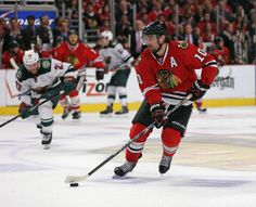 CHICAGO, IL - MAY 11: Patrick Sharp #10 of the Chicago Blackhawks brings the puck up the ice against the Minnesota Wild in Game Five of the Second Round of the 2014 NHL Stanley Cup Playoffs at the United Center on May 11, 2014 in Chicago, Illinois. The Blackhawks defeated the Wild 2-1. (Photo by Jonathan Daniel/Getty Images)