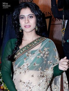 I like the emerald blouse pairing w/ the flower embroidered sheer saree