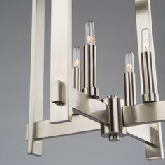 Cityscape Views - Artcraft Lighting's Cityscape series features wall sconces and pendants inspired by Cobi Ladner of Cobistyle. A unique design twist on a classical cage design -- Rectangular arms are tremendously eye pleasing. Consider other bulbs for a different style appeal... Globes? Frosted? Longer tubes?  It's up to you.  Available in three sizes for right-sizing in your entry, bedroom, dining or living spaces.  Choose between Brushed nickel or oil rubbed bronze finish. Bronze Wall Sconce, Bronze Chandelier, Chandelier Lighting, Wall Sconces, Polished Nickel, Brushed Nickel, Oil Rubbed Bronze, Bronze Finish, Bulbs