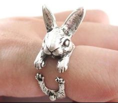 Inspired by Alice In Wonderland , adjustable Rabbit ring . Would make a lovely little gift. Colour : Antique silver Design: Rabbit Size: Adjustable I only ship to the UK at the moment :)
