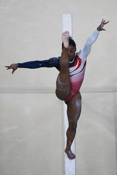 Simone Biles of the United States competes on beam during the women's team gymnastics final on Tuesday August 9 2016 The United States women won the. Gymnastics Tricks, Gymnastics Poses, Amazing Gymnastics, Gymnastics Photography, Gymnastics Pictures, Sport Gymnastics, Artistic Gymnastics, Olympic Gymnastics, Olympic Sports