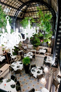 RESTAURANT LES 4 SERGENTS. LA ROCHELLE, FRANCE DESIGN: OCTANT DESIGN LA ROCHELLE 2011 PHOTOGRAPHER: FABRICE POUPLIER PRODUCTS: PAPER CHANDELIER 5 O'CLOCK CHAIR