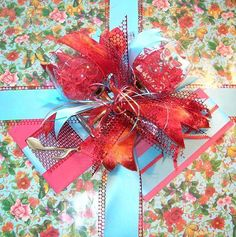 Butterfly gift wrap, with wine glasses and musical note ornament, gift certificates, and card, as gifts for a night of music and romance.