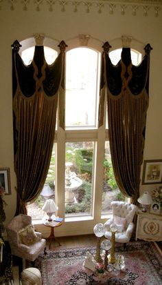 Grandeur Designs... Love the window treatments...