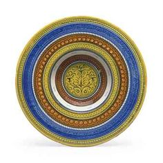 A FAENZA MAIOLICA PLATE LATE 15TH/EARLY 16TH CENTURY Of cardinal's hat form, painted with a central 'candelabrum' among scrollwork, within concentric patterned bands including trellis and pearls