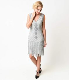 For those who adore vintage dresses that stand out from the crowd, youll love the artistic appeal of the silver Aelita flapper from Unique Vintage! This art deco drenched flapper dress boasts a knee-length shift style silhouette in a softly lined chiffon