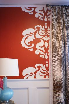 large stencil portion on wall as accent wall decor - this would look awesome if we paint A's room orange - just one line down a wall and maybe another line down another wall