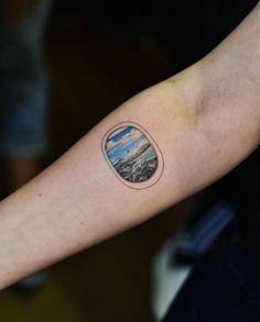 Airplane window tattoo by Drag Ink