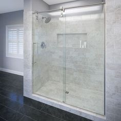 """Basco Rolaire 76"""" x 47"""" Single Sliding Fixed Panel Shower Door Trim Finish: Brushed Stainless Steel, Glass Type: AquaGlideXP Clear Glass"""
