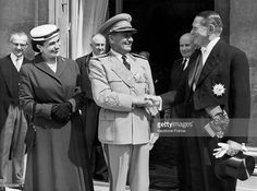The head of the Yugoslav government Josip Broz Tito (C), with his wife Jovanka Broz, shaking hands with the President of the French Republic Rene Coty (R) on the steps of the Elysee on May 7, 1956 in Paris, France