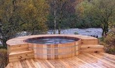 A hot tub is nothing more than a tub full of hot water. A hot tub may come with massaging jets, whirlpools, water pumps, heating and filtering systems, etc. Jacuzzi is a company that manufactures hot tubs. Whirlpool Deck, Wood Tub, Hot Tub Backyard, Backyard Kitchen, Stock Tank Pool, Saunas, Design Hotel, Patio Design, Garden Design
