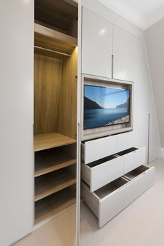 Bespoke joinery unit with timber lined TV recess. Handless sprayed doors and veneered wardrobe carcassing to match the TV recess. with tv Comfortable and Suitable Wardrobe Design for Big & Small Bedroom Wardrobe Tv, Wardrobe Design Bedroom, Sliding Wardrobe Doors, Tv In Bedroom, Closet Bedroom, Home Decor Bedroom, Bedroom Kids, Diy Bedroom, Room Decor