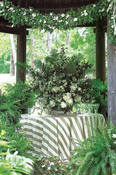 Adelicate cake nestled beneath a centerpiece of ferns, miniature roses and peonies / http://www.deerpearlflowers.com/greenery-fern-wedding-ideas/