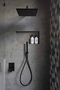 In this modern bathroom, the shower has a matte black rainfall shower head and a hand held shower head, as well as a tiled built-in shelf. - In this modern bathroom, the shower has a matte black rainfall shower head and a. Bad Inspiration, Bathroom Inspiration, Bathroom Ideas, Bathroom Renovations, Bath Ideas, Bathroom Organization, Bathroom Storage, Bathroom Layout, Bathroom Shelves