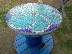 Bring new life to an old Cable Spool. Mosaic tile design and a little metallic spray paint!